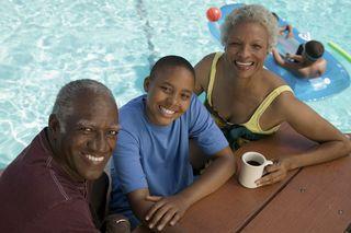 Bigstock-Grandparents-and-Grandson-Sitt-31858853