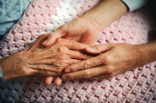 Elderlyhands and young hands